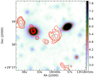 An example of a galaxy where visual identification of the radio components is necessary. Automated algorithms would have classified the non-core emission as independent sources, whereas RGZ volunteers (in agreement with the science team) found all five radio emission components in the upper half of the image to be related to the same source.